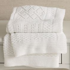 Gorgeous! Clean & simple white snugglies... Knitted Patchwork Baby Blanket