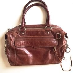 Rebecca Minkoff Cognac Brown Large MAB ❗️Reduced from $200❗️Authentic Rebecca Minkoff MAB bag. Overall great preloved condition, minor signs of wear include the piping exposed on one corner (all other corners in fact).  ❌No trades❌Price firm unless bundled.Bundles of 3+ items qualify for 15% discount with the bundle feature! Rebecca Minkoff Bags Satchels