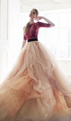 Unique cropped wedding dress with red lace top and orange tulle skirt; Featured Dress: CarouselFashion