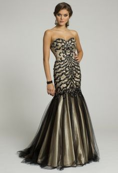 Slip into red-carpet, celebrity-style splendor in this incredibly stunning long dress designed by Jovani. This style features a beautiful, on-trend mermaid silhouette with amazing beaded bodice and full-drop waist trumpet skirt. It's strapless with a sweetheart neckline as well - perfection embodied! You'll love the fierce black and gold color combination too. Wear this as a Guest of Wedding dress, Prom dress, Homecoming Dress, formal Cocktail dress and even as a gorgeous Mother of the Bride…