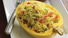 Spaghetti Squash Casserole ~ with sauteed onion, garlic, tomatoes, add in three cheeses & bake, YUM!  Only 158 calories and less than 6 g of fat per serving.
