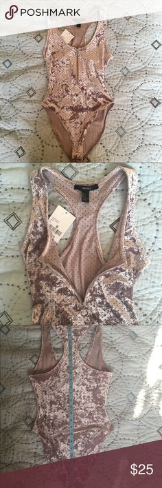 💙🌸Forever 21🌸 Crushed velvet bodysuit💋 Really pretty crushed velvet bodysuit. Zip up , and racerback. The color is almost a lilac / metalic color with a punched out circle design. Very sexy💋 Forever 21 Tops