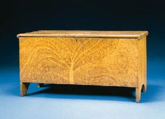 A YELLOW COMB-DECORATED BLANKET CHEST  NEW ENGLAND, EARLY 19TH CENTURY