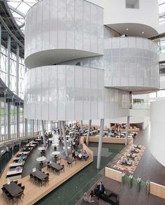 Technology giant Barco officially moves into its new Kortrijk campus. The new headquarters, 'The Circle', is the crowning jewel. The circular, transparent icon takes centre stage on the campus, with the goal of connec. Corporate Interiors, Office Interiors, Office Interior Design, Interior And Exterior, Library Design, Staircase Design, Atrium, Commercial Interiors, Restaurant Design