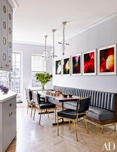 photo-based works by Walead Beshty; the Bethan Laura Wood pendant lamps are from Nilufar, and the custom-made BDDW table is surrounded by vintage Mathieu Matégot dining chairs and a banquette by Rafael de Cárdenas in a Holly Hunt leather. Banquette Seating In Kitchen, Kitchen Table Chairs, Kitchen Benches, Dining Nook, Dining Room Design, Dining Chairs, Booth Dining Table, Booth Seating In Kitchen, Settee Dining