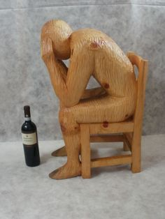 Arolla #pine #wood #sculpture by #sculptor Luigi Bartolini titled: 'Regret (Carved 3/4 Lifesize Man Chair statue)'. #LuigiBartolini