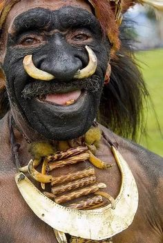 Papua New Guinea - A pig's tusk nose decoration worn by a man from the Highlands. Photo by Eric Lafforgue, We Are The World, People Around The World, Around The Worlds, Cultures Du Monde, World Cultures, Eric Lafforgue, Anthropologie, Tribal People, Many Faces