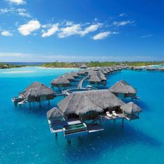 Ritz Carlton, Bora Bora.  Someday I will be in this picture, not just dreaming about it!