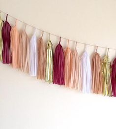 Add instant cheer to any party with this colorful tassel garlands. The frilly bits of tissue add color, shine and movement to bridal showers, wedding photo booths, baby showers, birthdays, graduations or walls on any regular old day. This garland contains tassels in metallic gold, claret red, peach blush, white and mocha to match the décor for your special occasion.