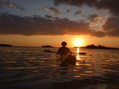 Kayaking at sunset.  <3
