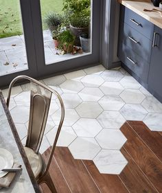 Hexagonal marble tiles meet floorboards - topps tiles - tiles awful but good way to join flooring // More classy style inspirations at evanescentescape.com