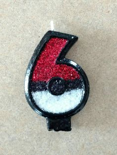 I painted & glittered a birthday cake candle to look like a Pokeball for a Pokemon themed party.