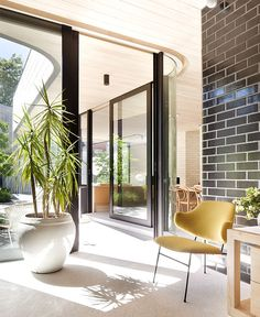 Brick House with Smooth Curves curved glazed wall