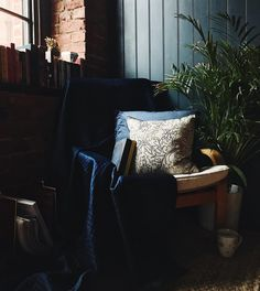 William Morris cushion navy nevlet pillow throw living room inspo interiors inspiration exposed brick indoor plants farrow and ball Hague blue moody Manchester Hague Blue, Cosy Corner, Exposed Brick, William Morris, Wingback Chair, Indoor Plants, Interior Inspiration, Manchester, Accent Chairs