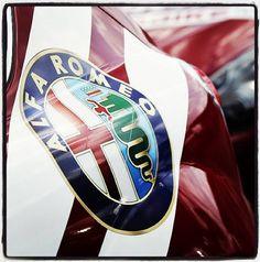 The Alfa Romeo logo.