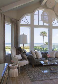 Coastal chic shingle-style gambrel home in sunny Florida