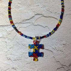 Puzzle piece pendant on beaded necklace  by findingallthepieces, $10.00
