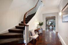 Dark stained recycled parquetry and timber floors introduce this stunning staircase