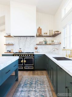 Fabulous kitchen by Amber Lewis - Amber Interiors - Love the drama of the high ceilings. No uppers! hooray! Lovely blue shaker cabinets, marble back splash and counters - brass fixtures and a fabulous Oriental runner,