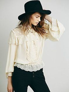 Embroidered Victorian Ruffle Top | Victorian inspire blouse featuring a lace high neck with delicate iridescent button closures.  Eyelet and crochet ruffle detailing.  Eyelet trim on the hem and cuffs.  Stretchy elastic waistband for an easy fit.