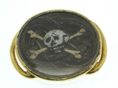 We have for sale a Magnificent Skull & Crossbones Memento Mori Slide Circa 1600's. The slide consists of an oval crystal compartment under which contains a lock of plaited hair upon which is set a Skull & Crossbones. | eBay!