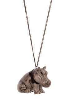 "Our very tame grey hippopotamus necklace.   The small hippo comes on an 24"" or 28"" brass based antique brass, gold or silver plate necklace.  This is also available on a 24"" sterling silver necklace."