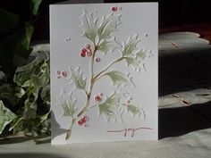 Simple emboss on white cardstock then using an eye make-up sponge highlight the leaves with sage, the berries with brick and the stem with forest - bjl