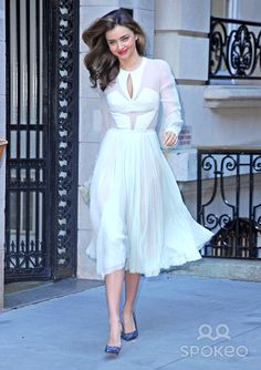 Model Miranda Kerr spotted out in a lovely white dress in New York City, New York on September 19, 2013.