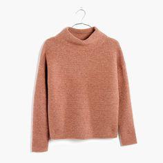 A reach-for-it-daily mockneck in a supersoft and cozy new yarn. With its easy cocoon shape, it's a sweater made for snuggling. <ul><li>Acrylic/wool/nylon/elastane.</li><li>Hand wash.</li><li>Import.</li></ul>