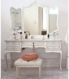 vanity table would make an excellent desk in guest room lots of small drawers for