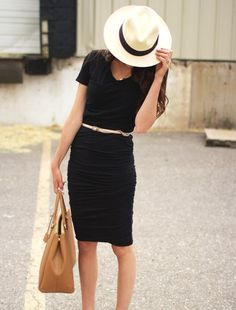Glam Hemingway inspiration: Casual black tee, ruched pencil skirt, metallic belt and a Panama hat.