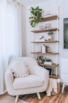 """A lounge chair that screams """"easy street"""" in every sense. Is it the bouclé fabric? The curvaceous proportions held up by a solid wood frame? How it will seamlessly suit the rest of your decor, regardless of your style? It's all this and more. Photo by Cherrie Lyn. #HomeDecor #InteriorDesign #InteriorDecor Apartment Living, Living Room, Zen Room, Interior Decorating, Interior Design, Solid Wood, Bookcase, Ivory, Shelves"""