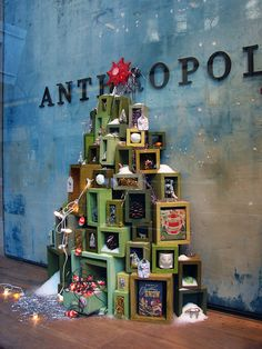 Anthropologie holiday window display // Christmas tree from stacked wooden boxes with gifts
