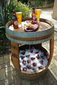 Patio beverage cooler/table made from old whiskey barrel.- What a great idea. I have a barrel, now I have something awesome to do with it Backyard Projects, Outdoor Projects, Backyard Patio, Backyard Ideas, Patio Ideas, Barrel Projects, Patio Bar, Firepit Ideas, Pallet Patio