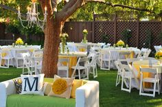 I really like this feel of the tables and chairs... Couch is a cool idea, but I'm not in love with it. I really love this girl's wedding... Basically wherever yellow is, we can substitue for navy