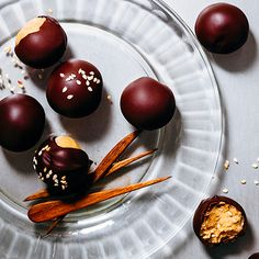 Spicy peanut butter balls via Garden & Gun. Benne seeds and chile-kicked chocolate raise the bar on a traditional party-time treat.