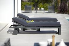 This is a black padded DNA sunbed with wheels available from IQ Furniture.