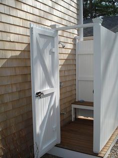 Outdoor shower.  I would love one of these for the kids after they are done mucking about outside! :)
