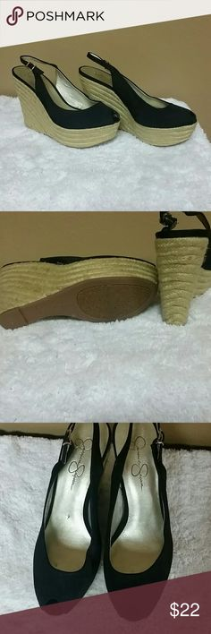 Jessica Simpson wedged heels Jessica Simpson black open toed wedged heels. Wedge is jute material. Great condition. Size 10 Jessica Simpson Shoes Wedges