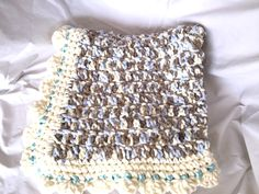 A personal favorite from my Etsy shop https://www.etsy.com/listing/252437845/softest-baby-blue-cream-bernat-blanket