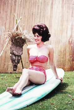 Pinup Prop Idea, have old surf board. Pin-up model c. 1963 with helmet hair!