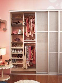 Pink Closet With View Of Sliding Panel Doors