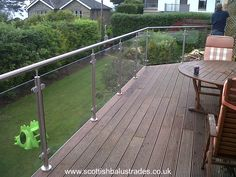 Stainless steel and glass balustrade on a decking area. Stainless Steel Balustrade, Glass Balustrade, Deck Design, House Design, Platform Deck, Decking Area, Home Id, Relaxing Places, Garden Inspiration