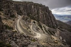 """The Alpe d'Huez, France? Cyclists are obsessed by these """"must-ride"""" alpine switchbacks, but actually this is Jacob's Ladder in Tasmania, not Le Tour de France's most legendary climb. New Zealand Lakes, Australian Photography, Big Ride, Alpe D Huez, Queenstown New Zealand, Lake Wakatipu, Months In A Year, Australia Travel, Continents"""