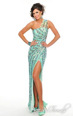 Precious Formals Style P8819 Hand sewn sequins radiate from the waist of the long beautiful gown with multiple shoulder straps and a cutout back.