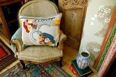 interior of Charleston House, home of Vanessa & Clive Bell; heart of Bloomsbury Group early c20th. cushion by Duncan Grant.