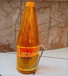 Lucozade in orange film wrapping. Strictly only allowed if you were genuinely ill.