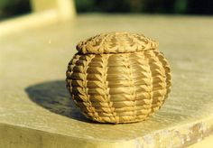 Sweetgrass basket made by Lorena Langley, basket weaver, Coushatta Tribe of LA.