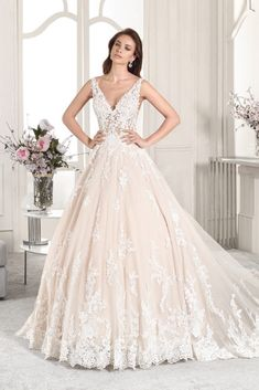 46b033e7951 Demetrios - Wedding Dress Style 874   Exquisite beaded Alencon lace adorns  this Organza Ball gown featuring a plunging V-neckline