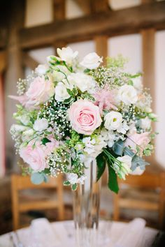 Tall table centre pieces with pink & white roses and gypsophila - Image by Hayley Savage - Classic Wedding At Gate Street Barn Surrey With Bride In Naomi Neoh Gown With A Pastel Colour Scheme Catering By Kalm Kitchen And Images From Hayley Savage Photography